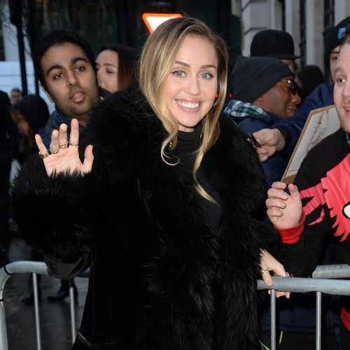 Miley Cyrus Puts Feminist Spin On Santa Baby 