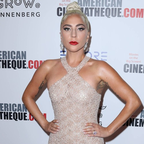 Lady Gaga Cuddles Golden Globe In Bed