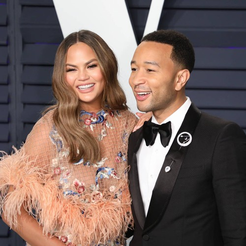 John Legend & Chrissy Teigen Squashed By Dwyane Wade During Basketball Game