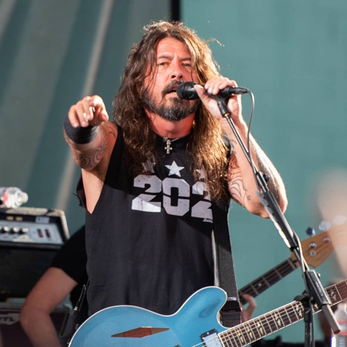 Dave Grohl invites crowd-surfing wheelchair user on stage