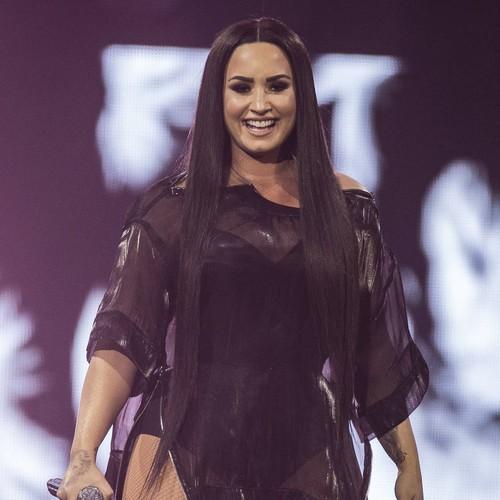 Demi Lovato celebrates 27th birthday at Ariana Grande's London concert