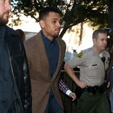 Chris-Brown-boarding-Con-Air-flight