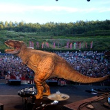 Elbow-fans-shocked-by-Tyrannosaurus-rex-at-Eden