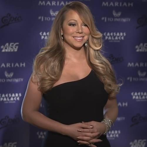 Mariah Carey gets touched up at gig